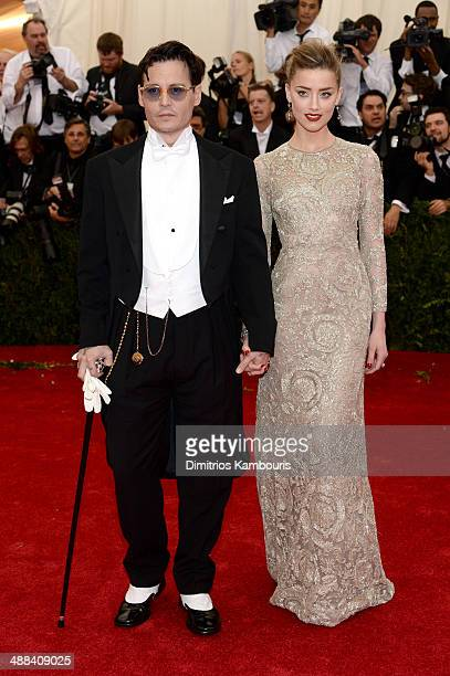 Actors Johnny Depp and Amber Heard attend the 'Charles James Beyond Fashion' Costume Institute Gala at the Metropolitan Museum of Art on May 5 2014...