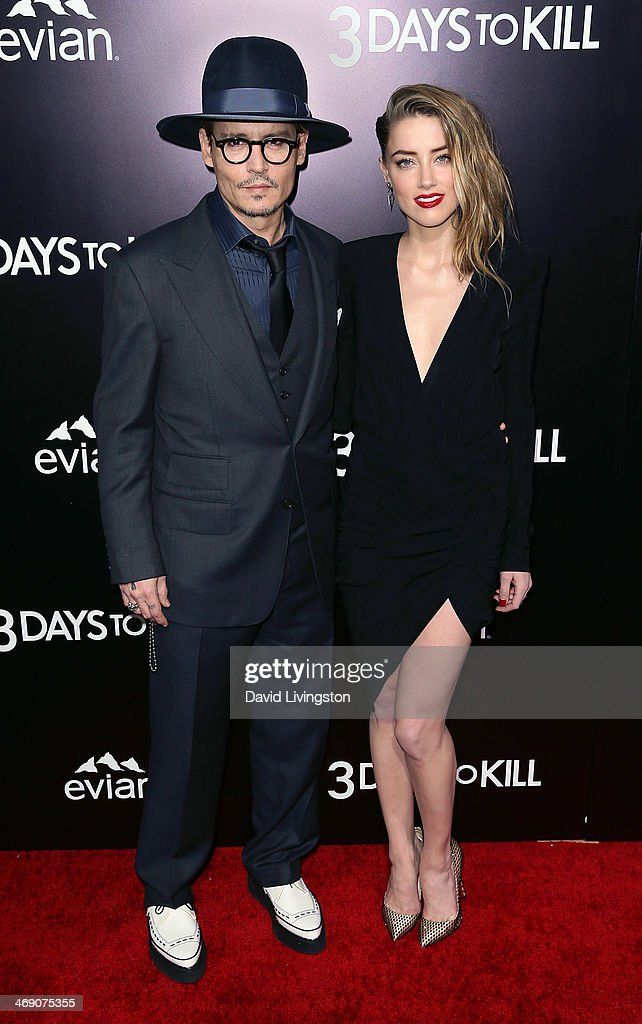 Actors Johnny Depp (L) and Amber Heardattend the premiere of Relativity Media's '3 Days to Kill' at ArcLight Cinemas on February 12, 2014 in Hollywood, California.