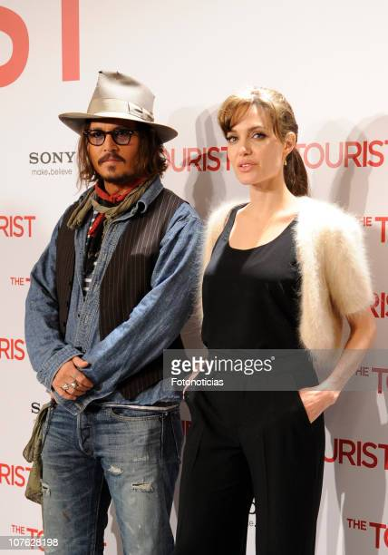 Actors Johnny Depp and Angelina Jolie attend 'The Tourist' photocall at the Villamagna Hotel on December 16, 2010 in Madrid, Spain.