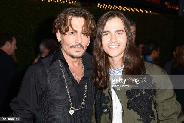 "Actors Johnny Depp and Anthony De La Torre at the Premiere of Disney's and Jerry Bruckheimer Films' ""Pirates of the Caribbean Dead Men Tell No Tales""..."