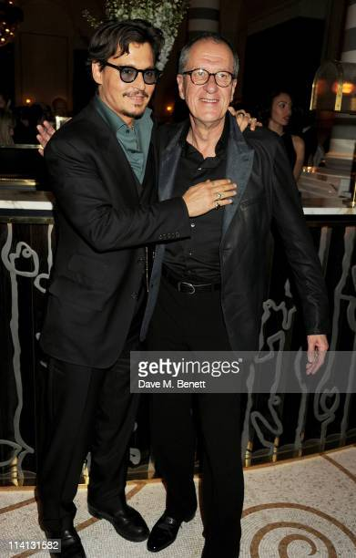 Actors Johnny Depp and Geoffrey Rush attend an after party celebrating the UK Premiere of 'Pirates of the Caribbean On Stranger Tides' at Massimo...