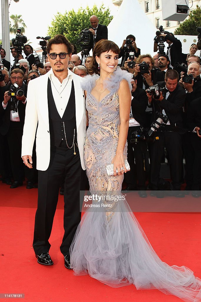 Actors Johnny Depp (L) and Penelope Cruz attend the 'Pirates of the Caribbean: On Stranger Tides' premiere at the Palais des Festivals during the 64th Cannes Film Festival on May 14, 2011 in Cannes, France.