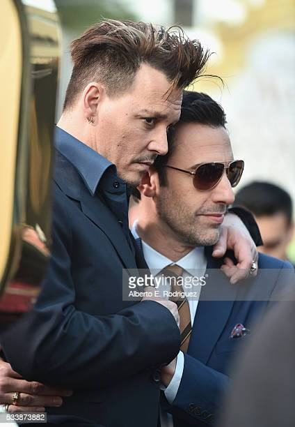 Actors Johnny Depp and Sacha Baron Cohen attend Disney's 'Alice Through the Looking Glass' premiere with the cast of the film which included Johnny...