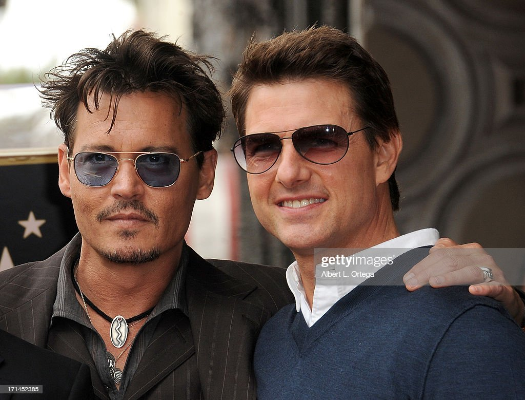 Actors Johnny Depp and Tom Cruise attend Jerry Bruckheimer's Hollywood Walk of Fame ceremony on June 24, 2013 in Hollywood, California.