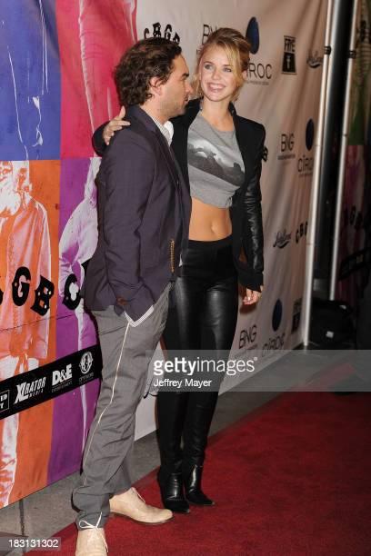 Actors Johnny Galecki And Kelli Garner Arrive At The Cbgb Special Screening At Arclight