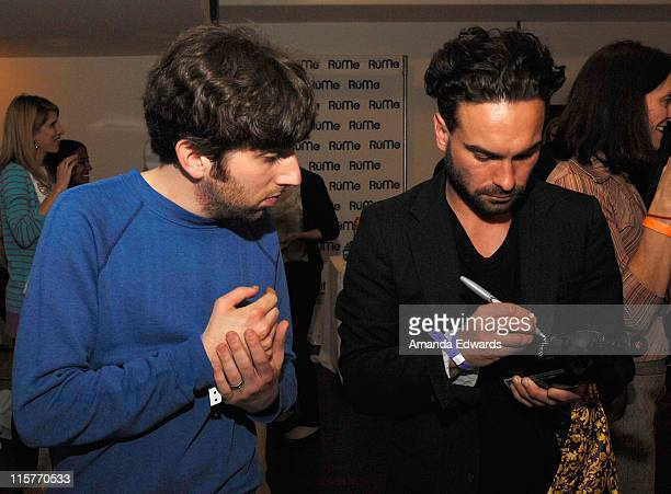 Actors Johnny Galecki and Simon Helberg pose at Little Black Dress Wines at Kari Feinstein Golden Globes Style Lounge held at Zune LA on January 9,...