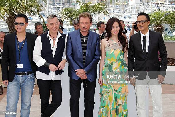 Actors Johnny Hallyday Anthony Wong Michelle Ye and Simon Yam attend the Vengeance Photo Call at the Palais des Festivals during the 62nd Annual...