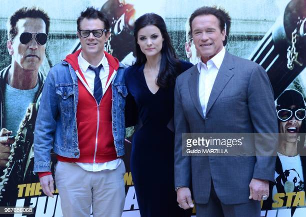 Actors Johnny Knoxville Jamie Alexander and Arnold Schwarzenegger pose during the 'The Last Stand' photocall on January 25 2013 in Rome Italy