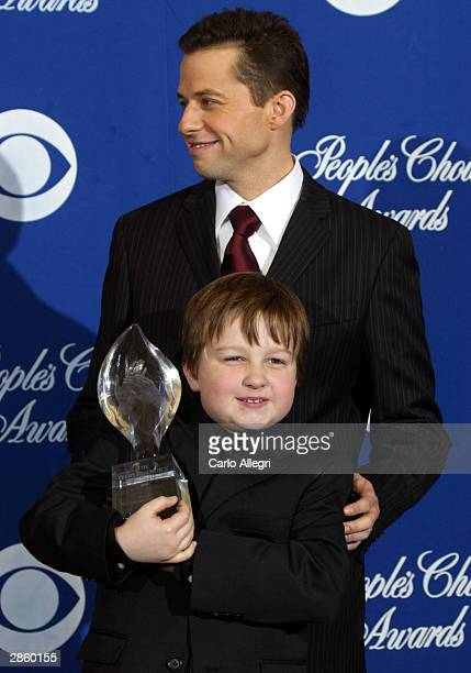 Actors Jon Cryer and Angus T Jones of Two and a Half Men pose backstage during the 30th Annual People's Choice Awards at the Pasadena Civic...