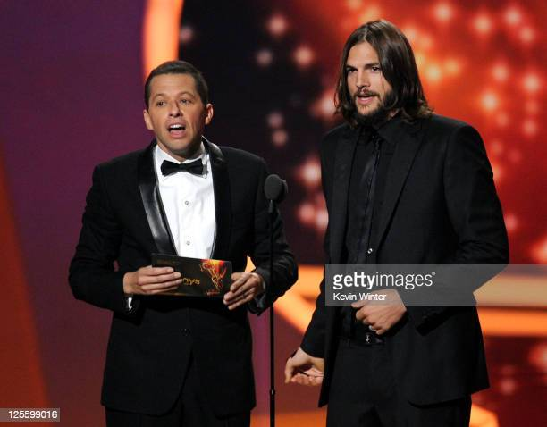 Actors Jon Cryer and Ashton Kutcher speak onstage during the 63rd Annual Primetime Emmy Awards held at Nokia Theatre LA LIVE on September 18 2011 in...