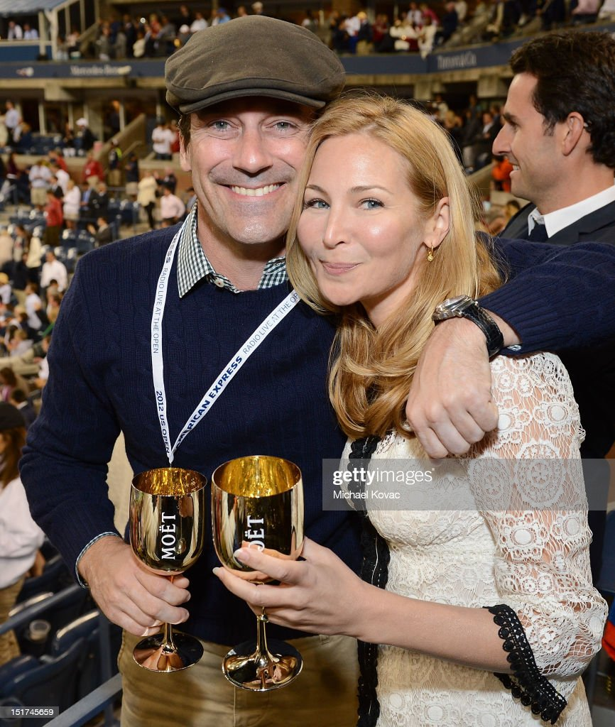 Actors Jon Hamm (L) and Jennifer Westfeldt visit the Moet & Chandon Suite at the 2012 US Open at the USTA Billie Jean King National Tennis Center on September 10, 2012 in the Flushing neighborhood of the Queens borough of New York City.