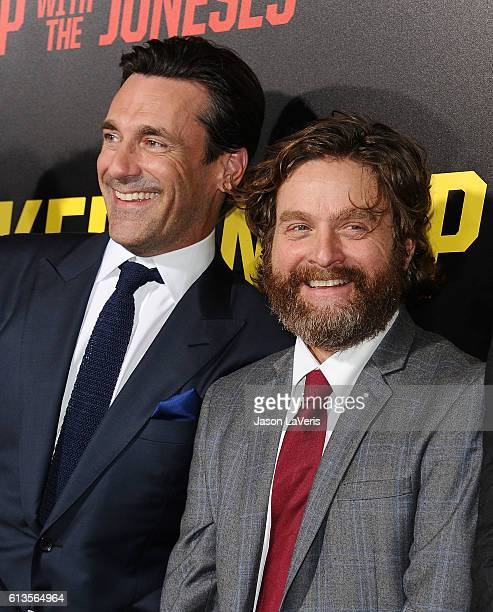 Actors Jon Hamm and Zach Galifianakis attend the premiere of 'Keeping Up with the Joneses' at Fox Studios on October 8 2016 in Los Angeles California