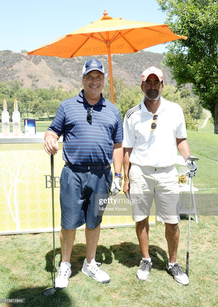Actors Jon Lovitz (L) and Tim Meadows attend The 4th annual Alex Thomas Celebrity Golf Classic presented by Belvedere at Mountain Gate Country Club on July 15, 2013 in Los Angeles, California.