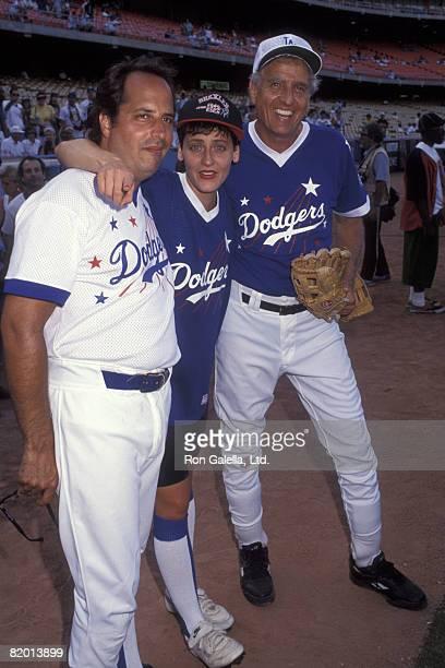 Actors Jon Lovitz Gary Marshall and actres Lori Petty attending Hollywood Stars Night on August 22 1992 at Dodger Stadium in Los Angeles California