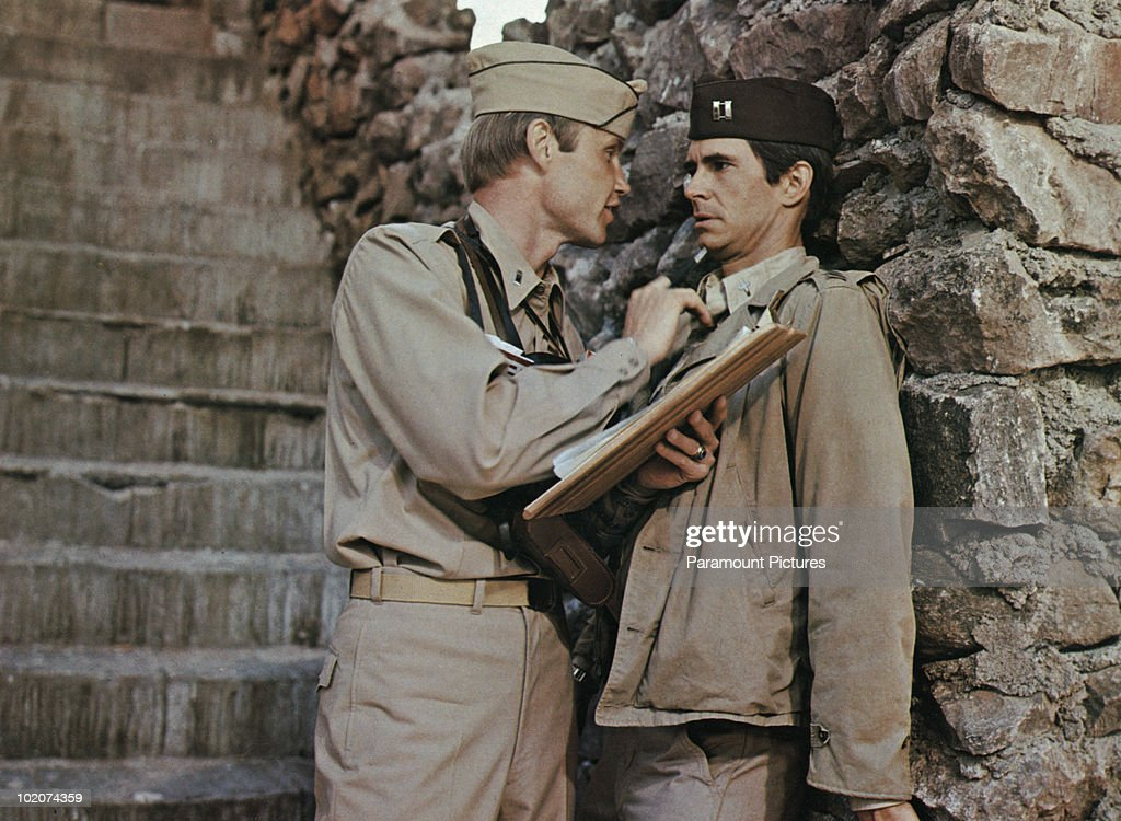 Actors Jon Voight (left) and Anthony Perkins (1932 - 1992) star in the film 'Catch-22', 1970.