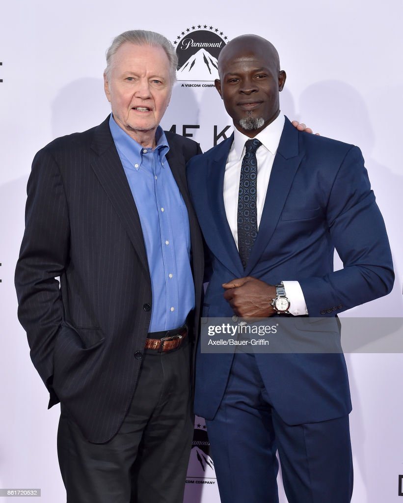 Actors Jon Voight and Djimon Hounsou arrive at the premiere of 'Same Kind of Different as Me' at Westwood Village Theatre on October 12, 2017 in Westwood, California.