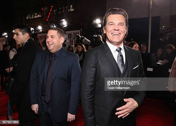 Actors Jonah Hill and Josh Brolin attend Universal Pictures' 'Hail Caesar' premiere at Regency Village Theatre on February 1 2016 in Westwood...