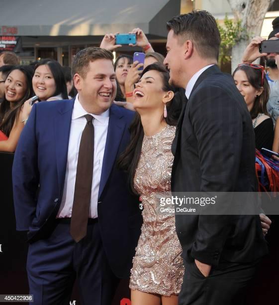 Actors Jonah Hill Jenna DewanTatum and Channing Tatum arrive at the Los Angeles premiere of 22 Jump Street at Regency Village Theatre on June 10 2014...