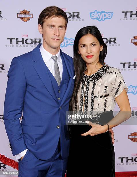 Actors Jonathan Howard and Elodie Yung arrive at the Los Angeles premiere of 'Thor The Dark World' at the El Capitan Theatre on November 4 2013 in...