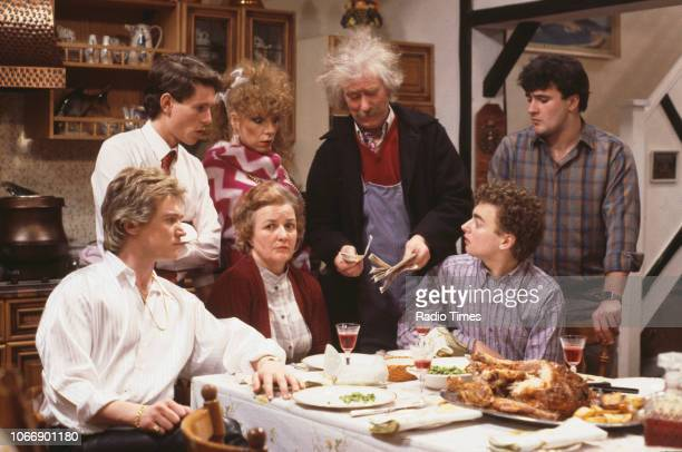 Actors Jonathan Morris Gilly Coman Ronald Forfar and Victor McGuire with Peter Howitt Jean Boht and Nick Conway in a scene from the BBC television...