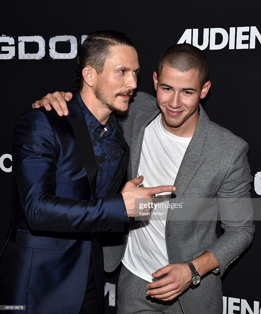 Actors Jonathan Tucker (L) and Nick Jonas attend the premiere of DIRECTV's 'Kingdom' Season 2 at SilverScreen Theater at the Pacific Design Center on October 6, 2015 in West Hollywood, California.