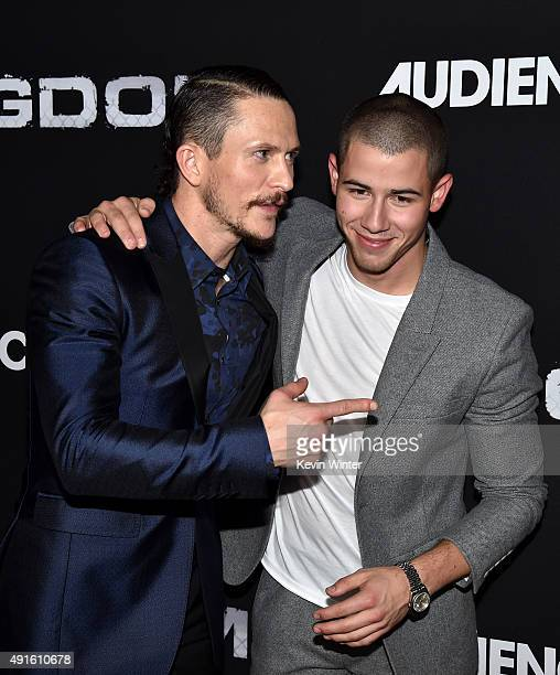 Actors Jonathan Tucker and Nick Jonas attend the premiere of DIRECTV's Kingdom Season 2 at SilverScreen Theater at the Pacific Design Center on...
