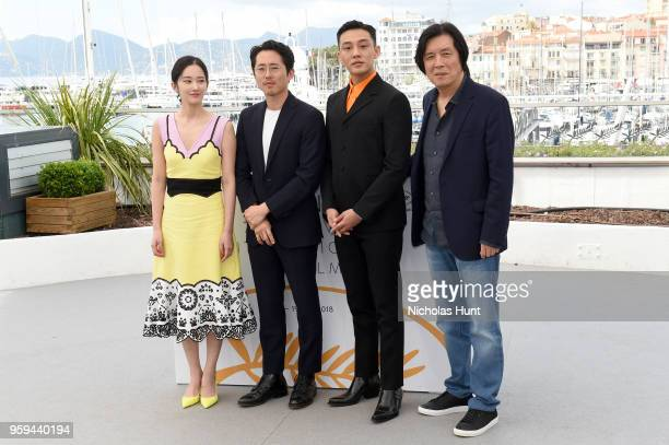 Actors Jongseo Jeon Steven Yeun Ahin Yoo and director Changdong Lee attend 'Burning' Photocall during the 71st annual Cannes Film Festival at Palais...