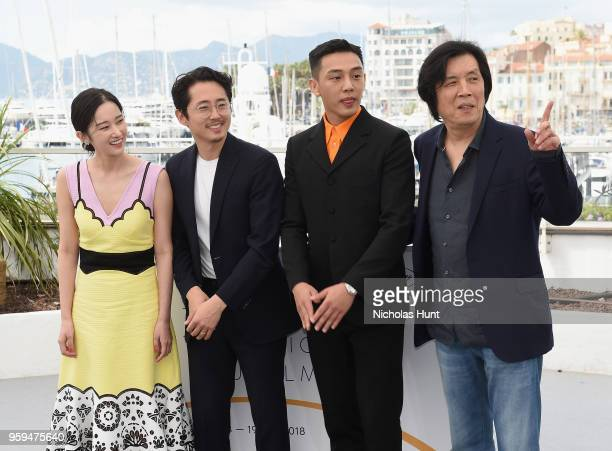 Actors Jongseo Jeon Steven Yeun Ahin Yoo and director Changdong Lee attend the 'Burning' Photocall during the 71st annual Cannes Film Festival at...