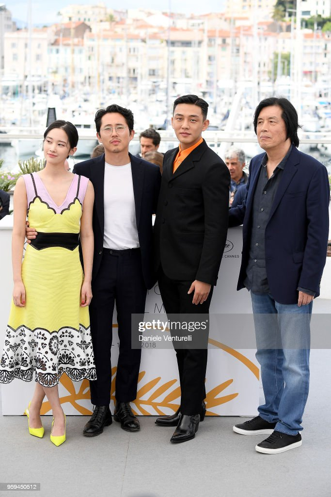 Actors Jong-seo Jeon, Steven Yeun, Ah-in Yoo and director Lee Chang-dong attend the photocall for the 'Burning' during the 71st annual Cannes Film Festival at Palais des Festivals on May 17, 2018 in Cannes, France.