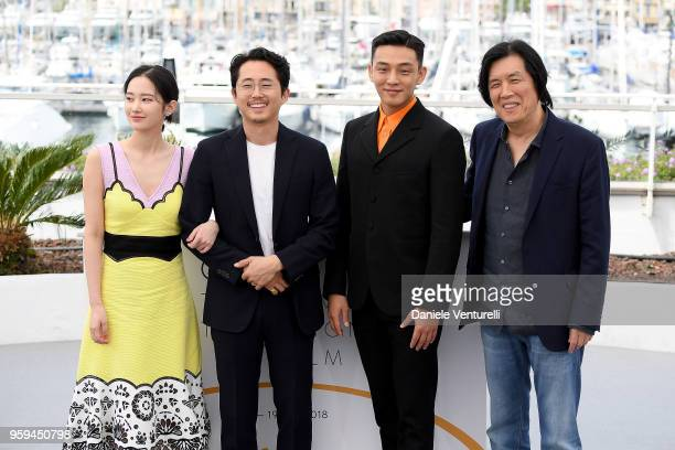 Actors Jongseo Jeon Steven Yeun Ahin Yoo and director Lee Changdong attend the photocall for the 'Burning' during the 71st annual Cannes Film...