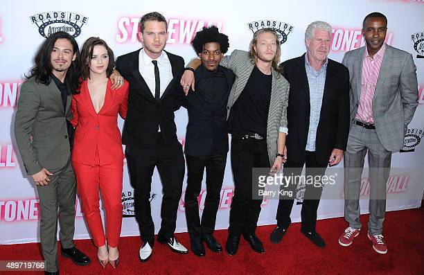 Actors Jonny Beauchamp Joey King Jeremy Irvine Vladimir Alexis Ben Sullivan Ron Perlman and Otoja Abit attend the premiere of Roadside Attractions'...