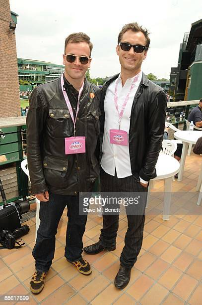 Actors Jonny Lee Miller and Jude Law attend the 'Evian Celebrity Hospitality Marque at Wimbledon on June 22 2008 in London England