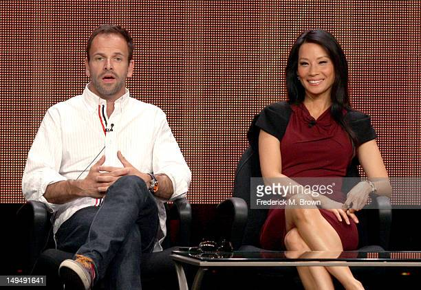 Actors Jonny Lee Miller and Lucy Liu speak at the Elementary discussion panel during the CBS portion of the 2012 Summer Television Critics...
