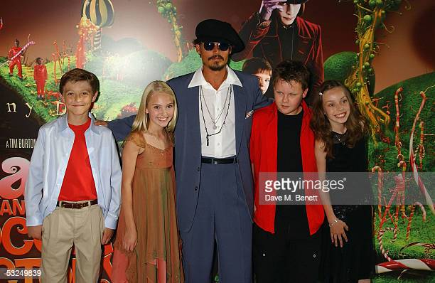Actors Jordan Fry Annasophia Robb Johnny Depp Phillip Wiegratz and Julia Winter arrive at the UK Premiere of 'Charlie And The Chocolate Factory' at...