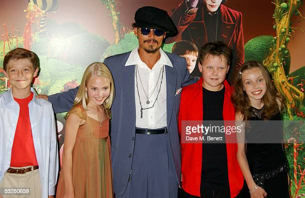 Actors Jordan Fry Annasophia Robb Johnny Depp Phillip Wiegratz and Julia Winter arrive at the UK Premiere of Charlie And The Chocolate Factory at the...