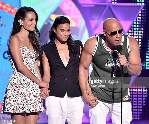Actors Jordana Brewster Michelle Rodriguez and Vin Diesel accept the Choice Movie Action Award for Furious 7 onstage during the Teen Choice Awards...