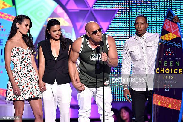 Actors Jordana Brewster Michelle Rodriguez Vin Diesel and Ludacris accept the Choice Movie Action Award for Furious 7 onstage during the Teen Choice...