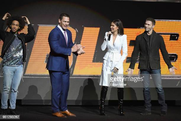 Actors Jorge Lendeborg Jr John Cena Hailee Steinfeld and director Travis Knight speak onstage during the CinemaCon 2018 Paramount Pictures...