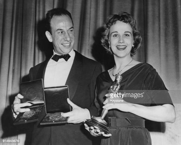 Actors José Ferrer and Kim Hunter present each other with recentlywon awards before the world premiere of their latest film 'Anything Can Happen' at...