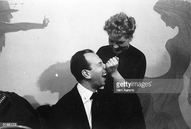 Actors Jose Ferrer and Judy Holliday winners of the Best Actor and Best Actress Oscars for 1951 celebrate their success at the La Zambra nightclub in...