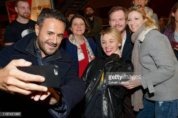 Actors Jose Garcia Anne Marivin and Alexandra Lamy pose for selfies with publicc as they attend the 'Chamboultout' Premiere on March 21 2019 in Lille...