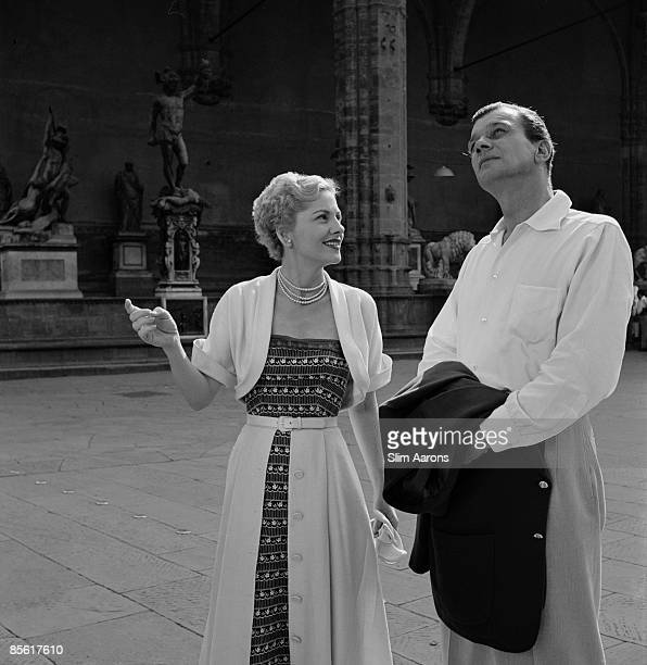 Actors Joseph Cotten and Joan Fontaine pose in the Piazza della Signoria Florence Italy during the location filming of 'September Affair' August 1949