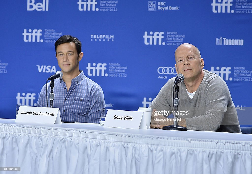 Actors Joseph Gordon-Levitt and Bruce Willis attend the 'Looper' press conference during the 2012 Toronto International Film Festival at TIFF Bell Lightbox on September 6, 2012 in Toronto, Canada.