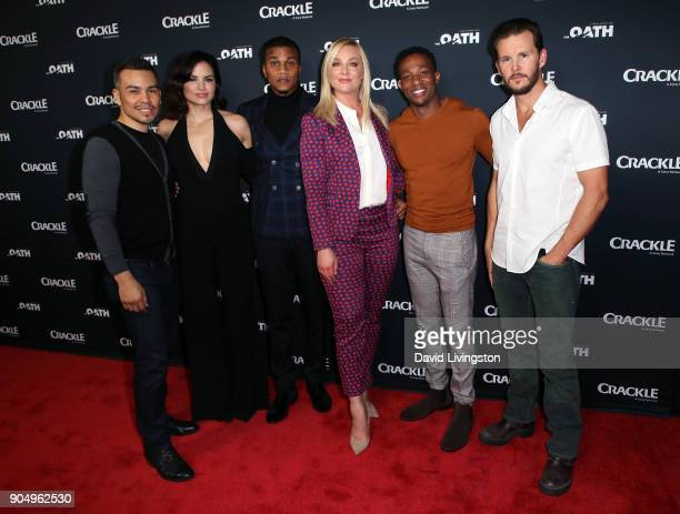 Actors Joseph Julian Soria Katrina Law Cory Hardrict Elisabeth Rohm Arlen Escarpeta and Ryan Kwanten attend a photo call for Crackle's 'The Oath' at...