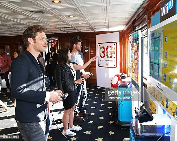 Actors Joseph Morgan and Daniel Gillies attend The Nintendo Lounge on the TV Guide Magazine yacht during ComicCon International 2015 on July 10 2015...
