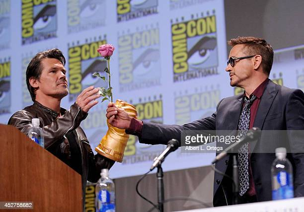 Actors Josh Brolin and Robert Downey Jr. Attend the Marvel Studios panel during Comic-Con International 2014 at San Diego Convention Center on July...
