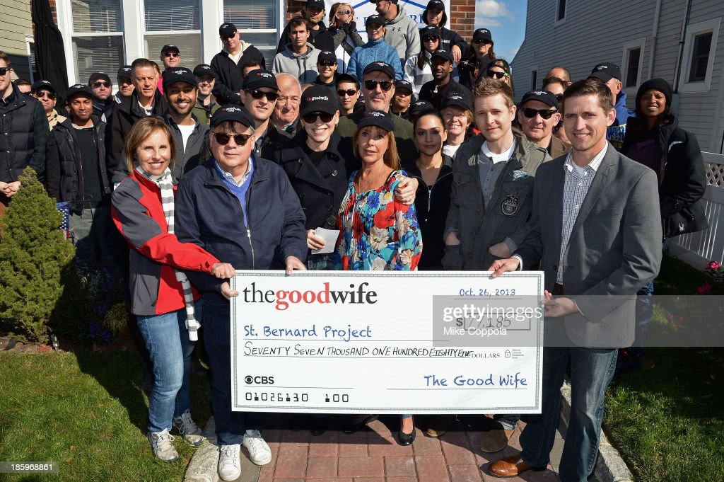 Actors Josh Charles, Jerry Adler, Julianna Margulies, Chris Noth, Archie Panjabi, Matt Czuchry, Zach Grenier present a check to the St. Bernard Project as The Cast Of 'The Good Wife' Celebrate Their100th Episode With A Day Of Service For The St. Bernard Project on October 26, 2013 in New York City.