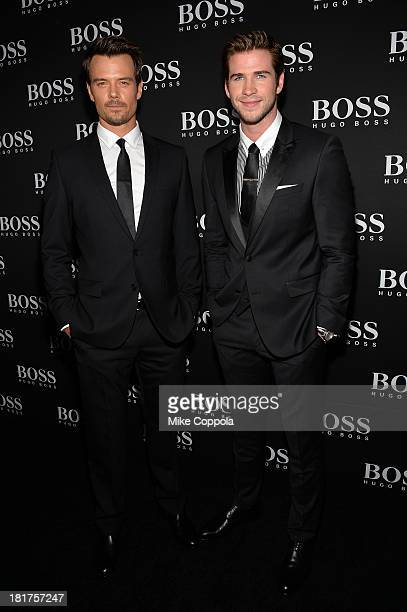 Actors Josh Duhamel and Liam Hemsworth attend HUGO BOSS celebrates Columbus Circle BOSS flagship opening featuring premiere of 'Anthropocene' by...