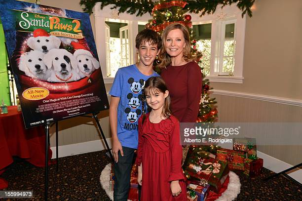 Actors Josh Feldman Kaitlyn Maher and Cheryl Ladd attend the 'Santa Paws 2 The Santa Pups' holiday party hosted by Disney Cheryl Ladd and Ali Landry...