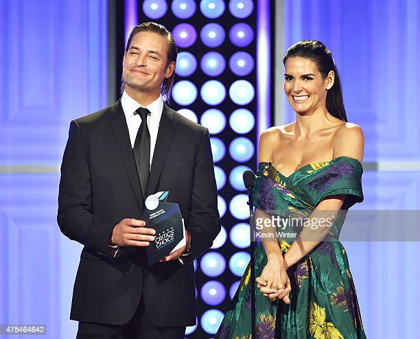Actors Josh Holloway and Angie Harmon speak onstage at the 5th Annual Critics' Choice Television Awards at The Beverly Hilton Hotel on May 31 2015 in...